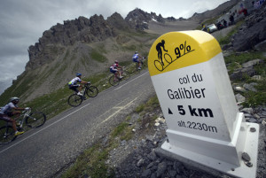 Chasers climb past a Galibier (2.556 m) milepost in the109,5 km and nineteenth stage of the 2011 Tour de France cycling race run between Modane Valfrejus and Alpe d'Huez ski resort, southeastern France, on July 22 , 2011.  AFP PHOTO / LIONEL BONAVENTURE (Photo credit should read LIONEL BONAVENTURE/AFP/Getty Images)